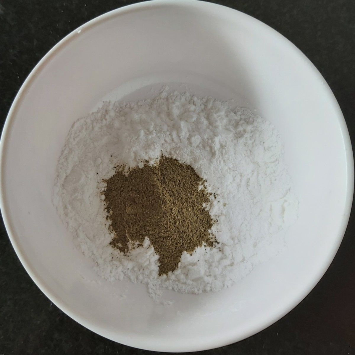 Meanwhile, in a bowl, take 2 tablespoons of corn flour and 1 teaspoon of pepper powder (can use black or white pepper powder).