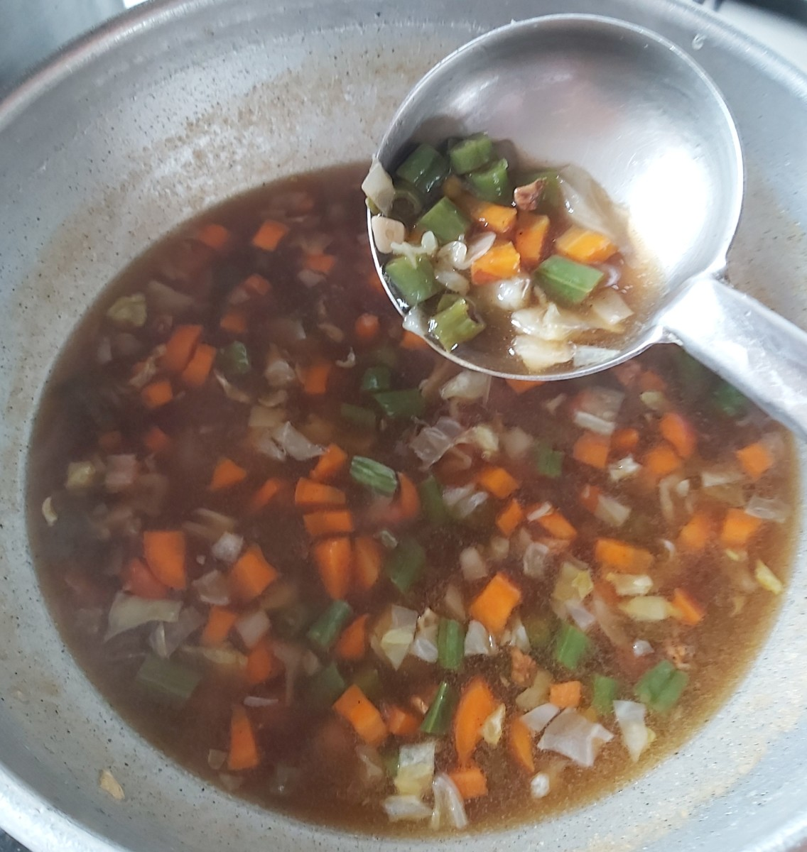 Add water if you feel your soup is too thick and more slurry if it is too thin (you can keep your soup thick or thin as per your preference). Adjust salt.   Add more sauces, vinegar and sugar if required.