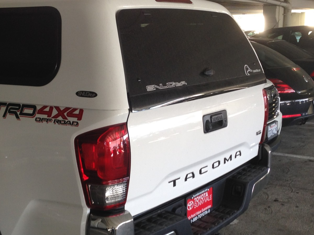 Notice on a 2016 Tacoma, the rear of the bed, and the top of the tailgate, now flare out the way many new trucks do. You can the flared out piece on the door of the shell where it meets the top of the gate.