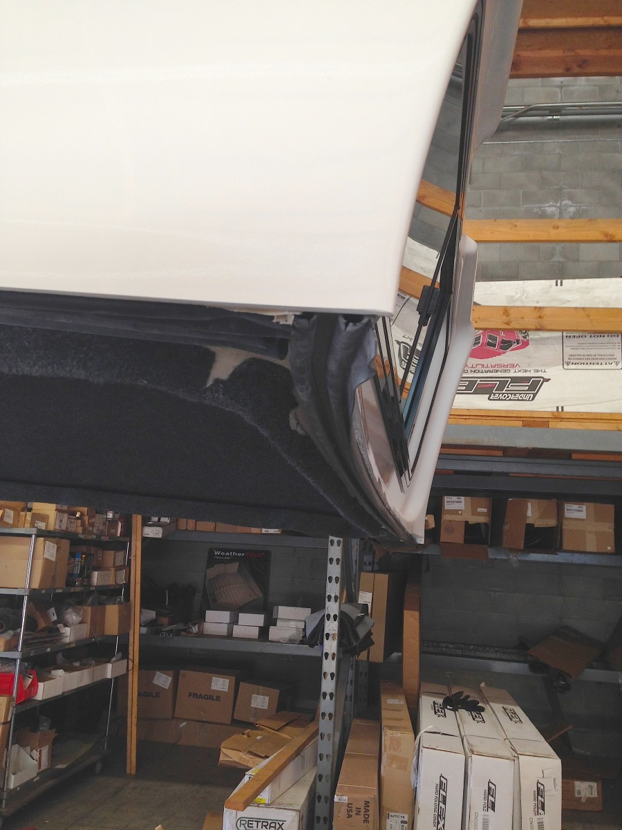 This is the front (sits behind the cab window) of a top for a new Ram bed. Notice how curved it is.