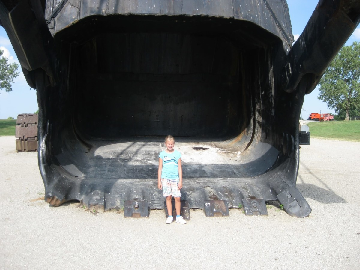 My daughter as a fifth grader standing in front of Big Brutus' massive bucket.