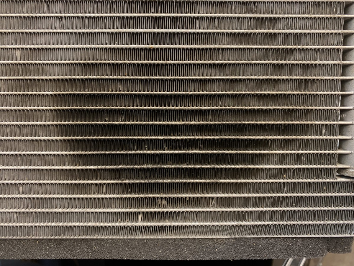 Oil spots on AC condenser cooling fins.