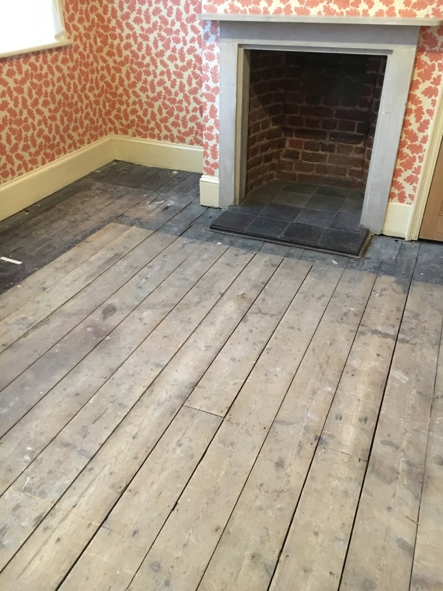 Uncovering old wood floors.