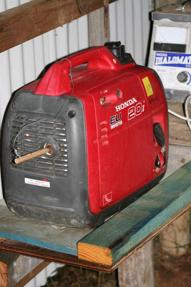 Our generator has worked hard for few years. It generally lives in our outdoor sheltered solar battery storage area, but also gets carted down to the shed and out into the orchard etc in mud (and rain). A simple stick stops mud wasps nesting in it.