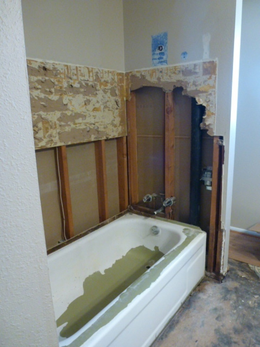 Most of the covering around the plumbing was also removed, making it easier to disconnect any from the tub and ensure that it wasn't broken in tub removal.