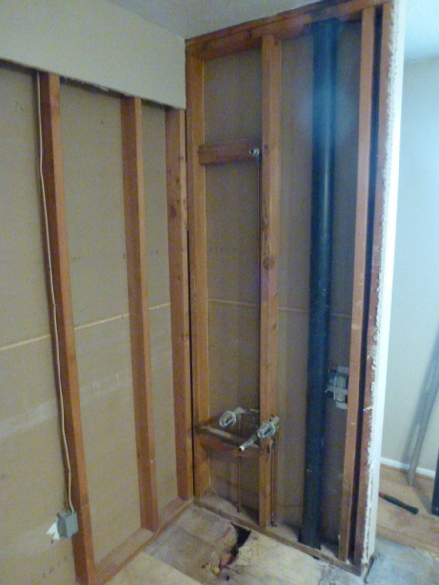 The tub is out, with but a small section of drywall to be removed yet.