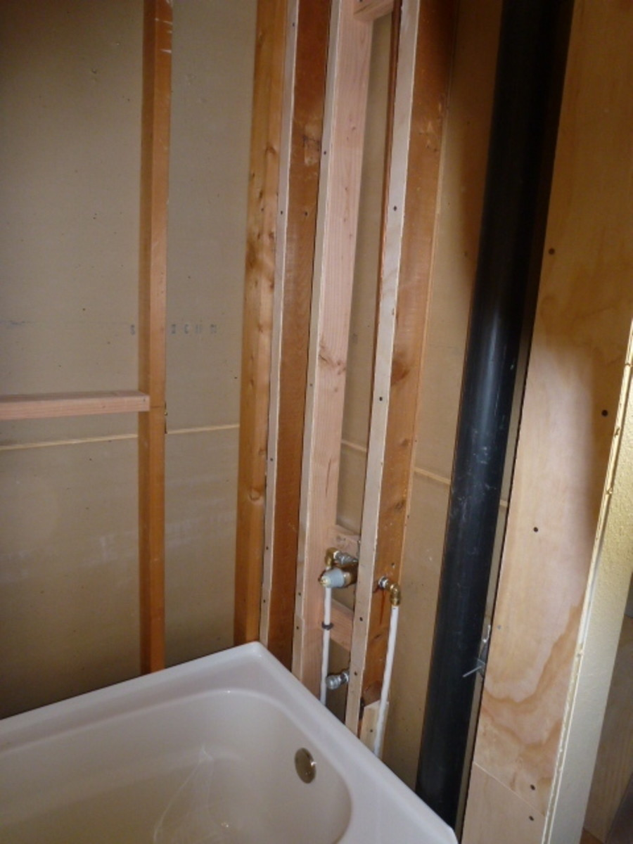 Furring on the end wall to shorten the space for the tub.
