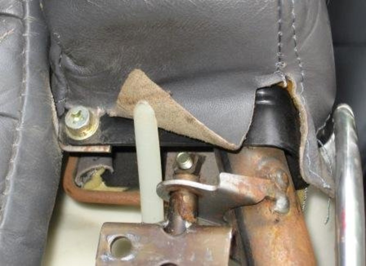 The white tool is flipping up the edge of the leather so we can see both sides of it and the edge. See how thick it is?