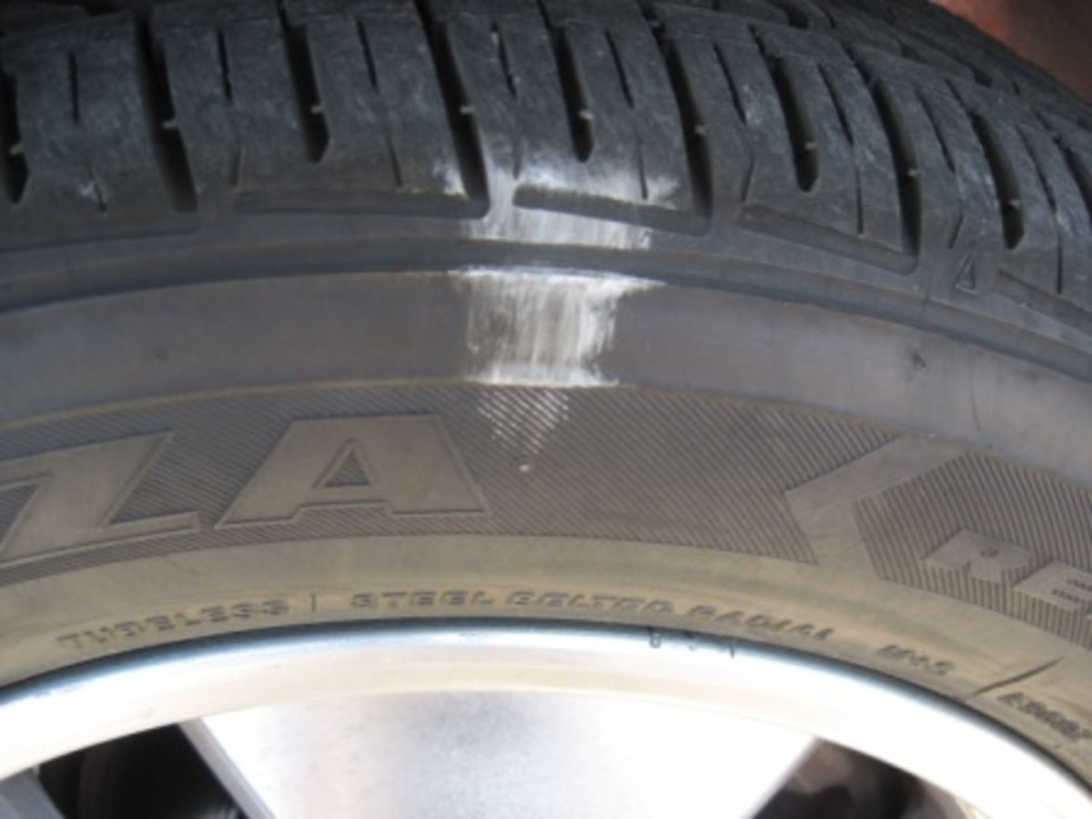 The outer front tire has more weight on it as the car leans and, therefore, uses the entire tread width, even when overinflated by 5 psi.