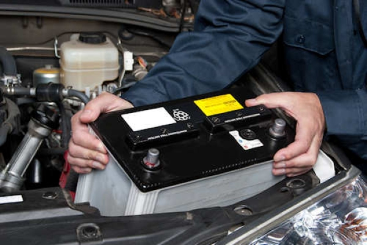 Replacing a car battery.