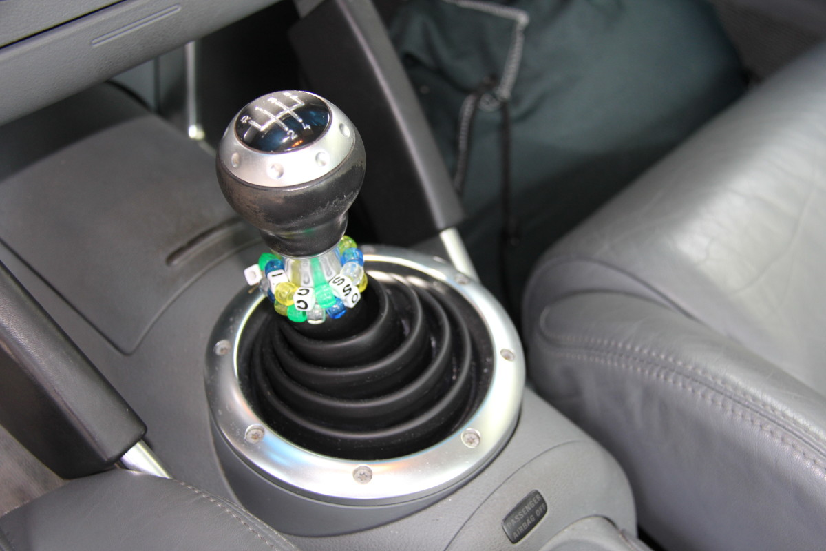 """This shift knob has visible wear on its surface.  It's from a 13-year-old car, with nearly 133,000 miles.  Check """"high-touch"""" surfaces that will see more wear to determine a car's age and road use for yourself."""