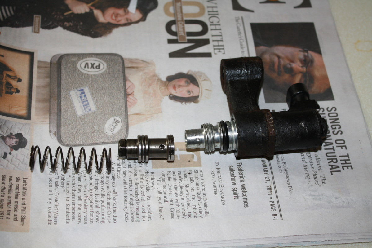 EVO valve, pressure relief piston, and spring, as they are inserted into the pump.