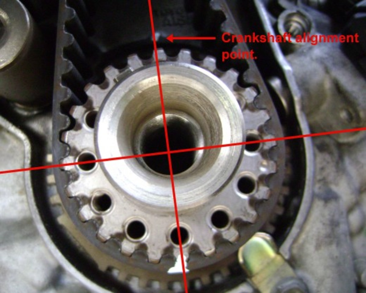 DD.  At TDC, apply paint marks to the old timing belt, crankshaft pulley, and engine.