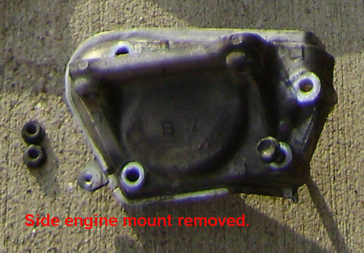 AA.  Side engine mount bracket removed