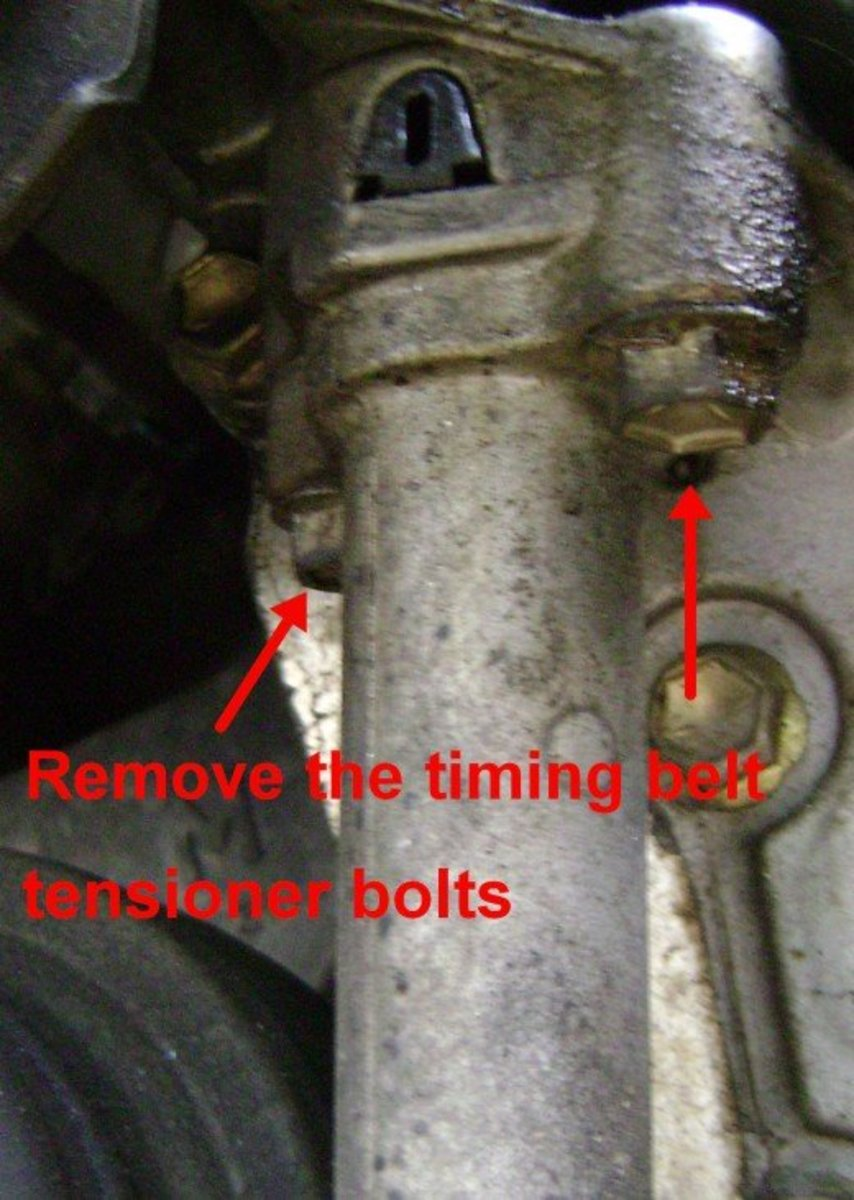 EE.  Remove the bolts to remove the timing belt tensioner.