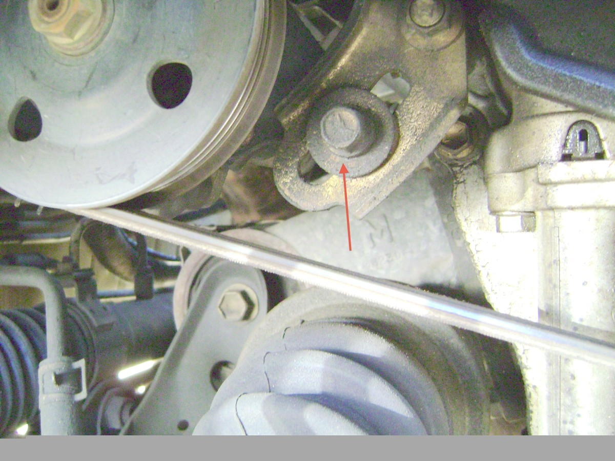 K.  Loosen and remove the power steering pump bracket bolt.