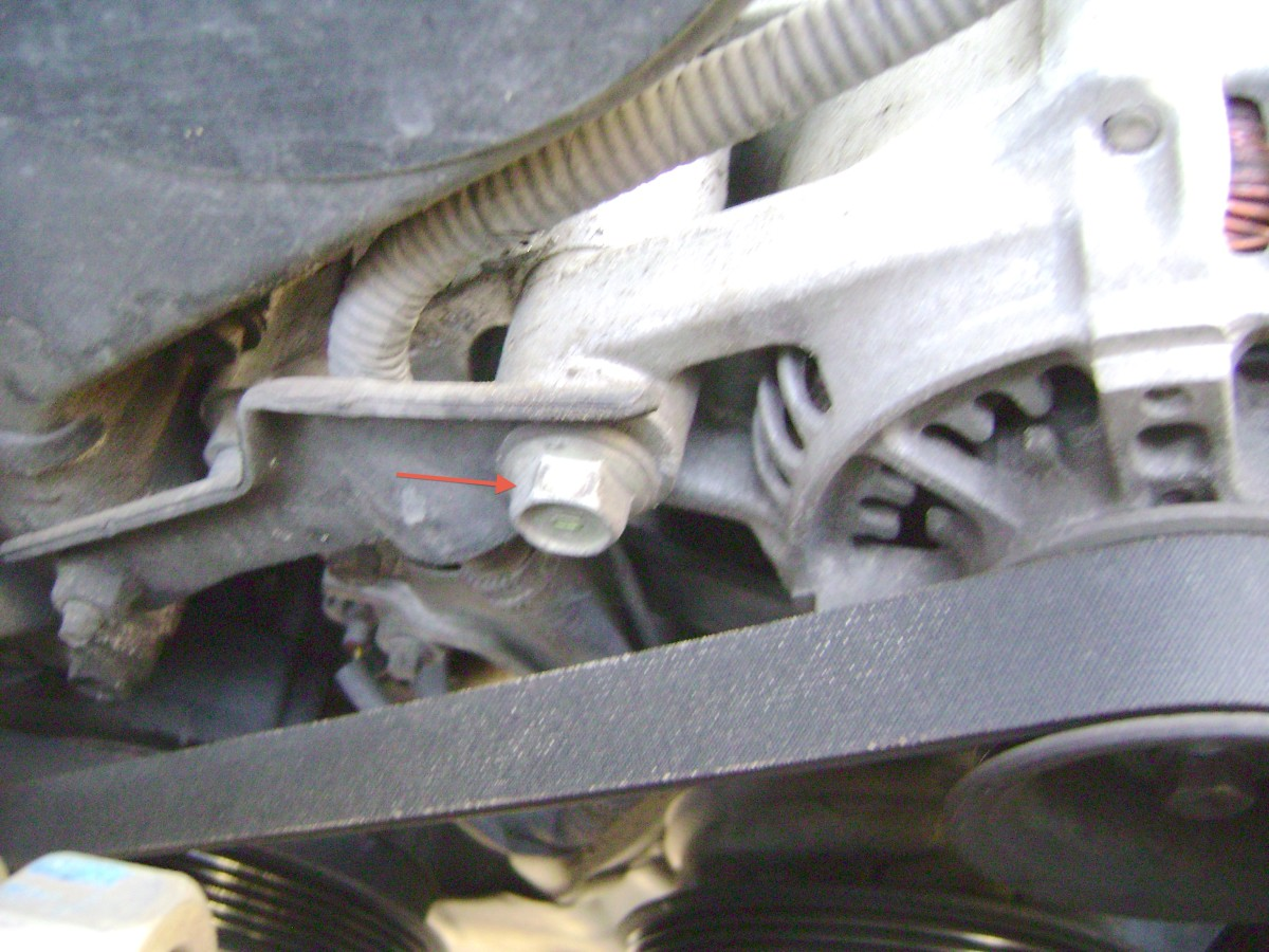 I.  Loosen the alternator bracket pivot bolt