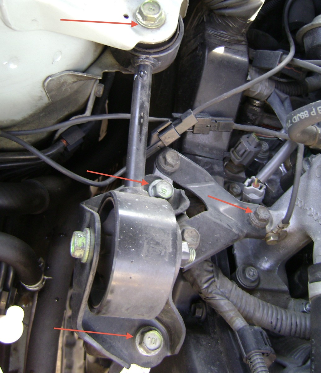 R.  Remove bolts in order to remove the side engine mount (torque rod).