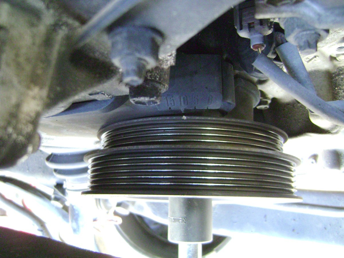 F. Align the crankshaft pulley's TDC mark between the 10 and 5 degree marks.