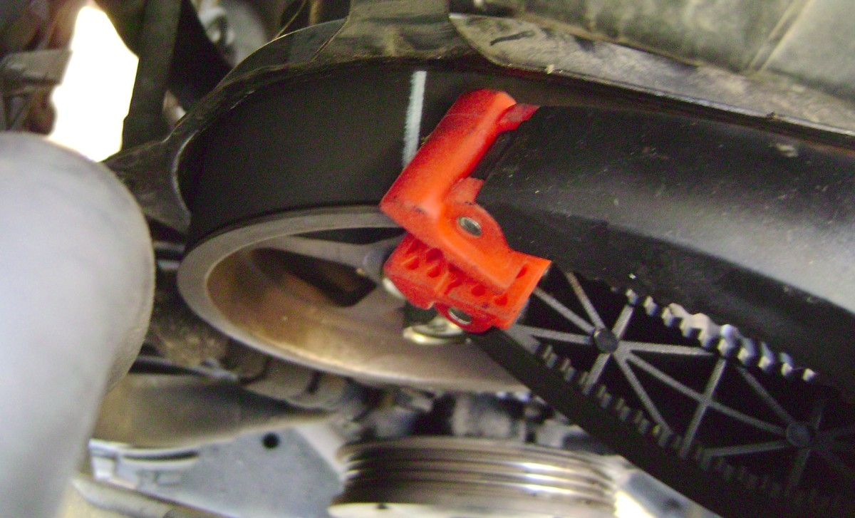HH.  Stretch the belt onto the left camshaft sproket.  Secure the belt onto the sprockets with plastic alligator clips.