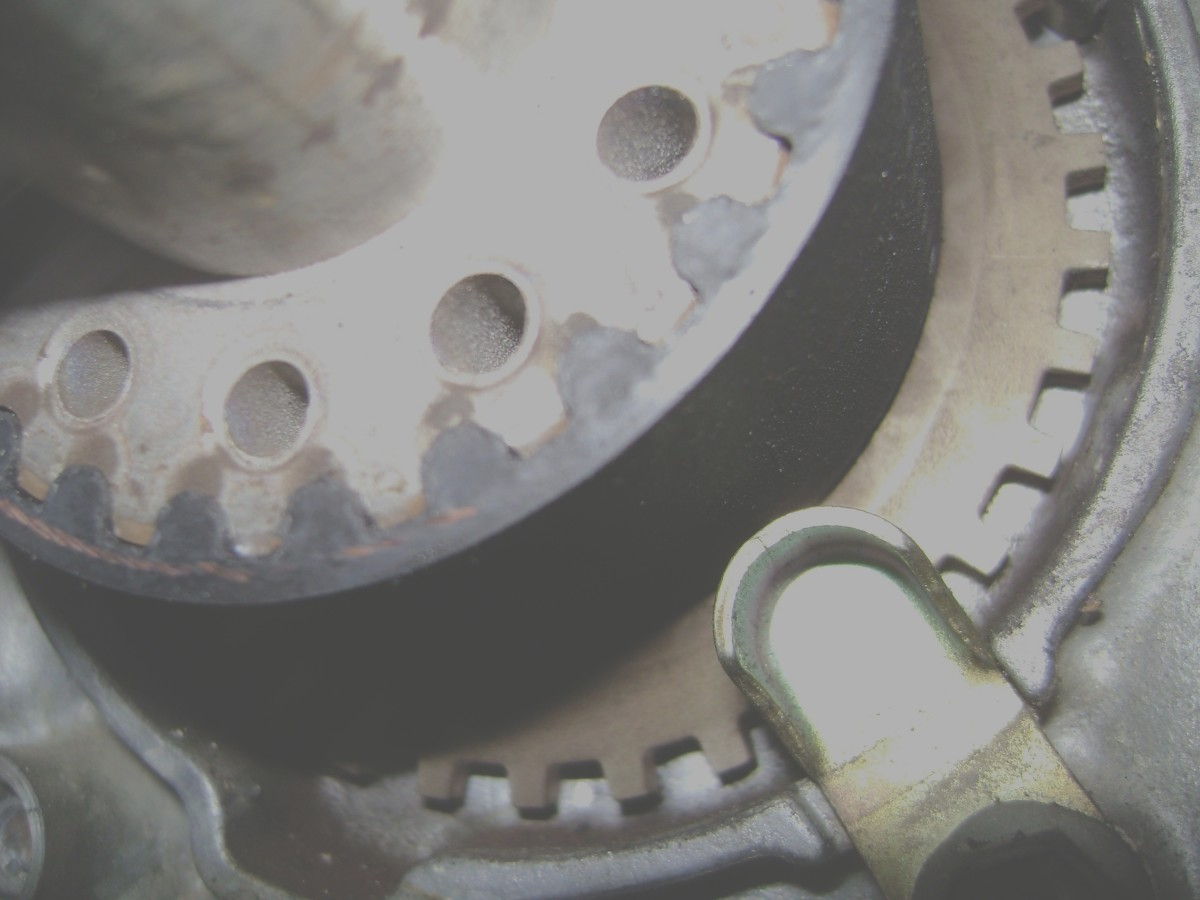 II.  Stretch the right side of the new belt onto the crankshaft pulley, leaving no slack between the crankshaft and right camshaft.  Hold it there with one hand, and with the other hand slip the left side of the belt over the belt tensioner pulley.