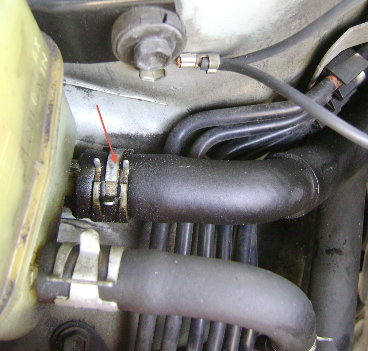 U.  (Optional) detach the power steering return line hose from the reservoir and move it to the firewall