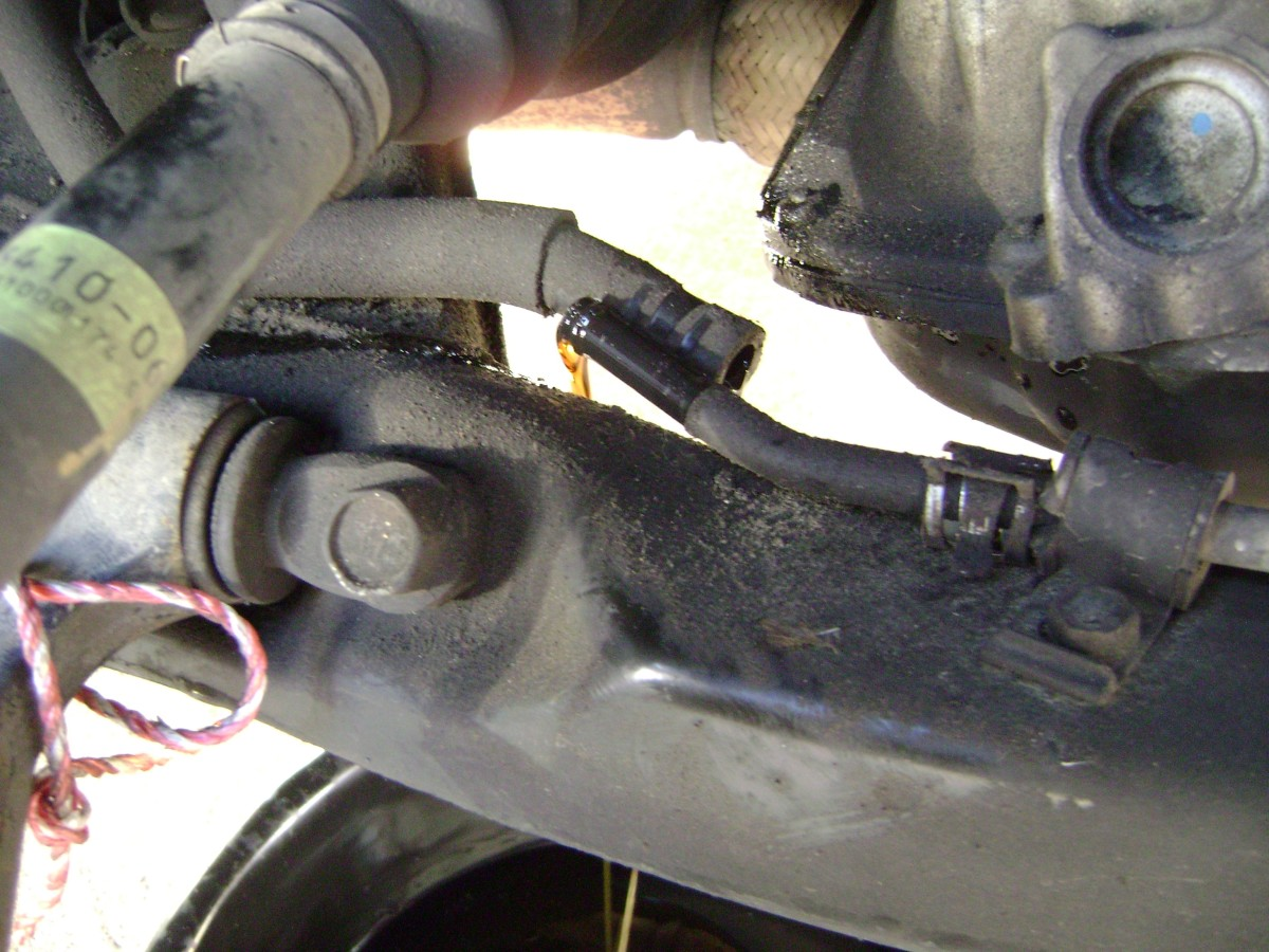 H.  Reconnect hose and clamp when fluid drainage is complete.