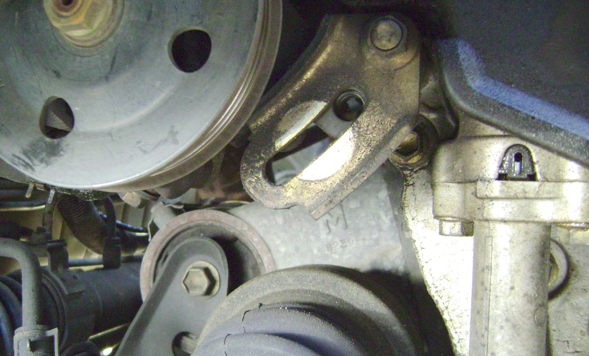 M.  Pivot the power steering pump to create slack in the power steering pump belt.