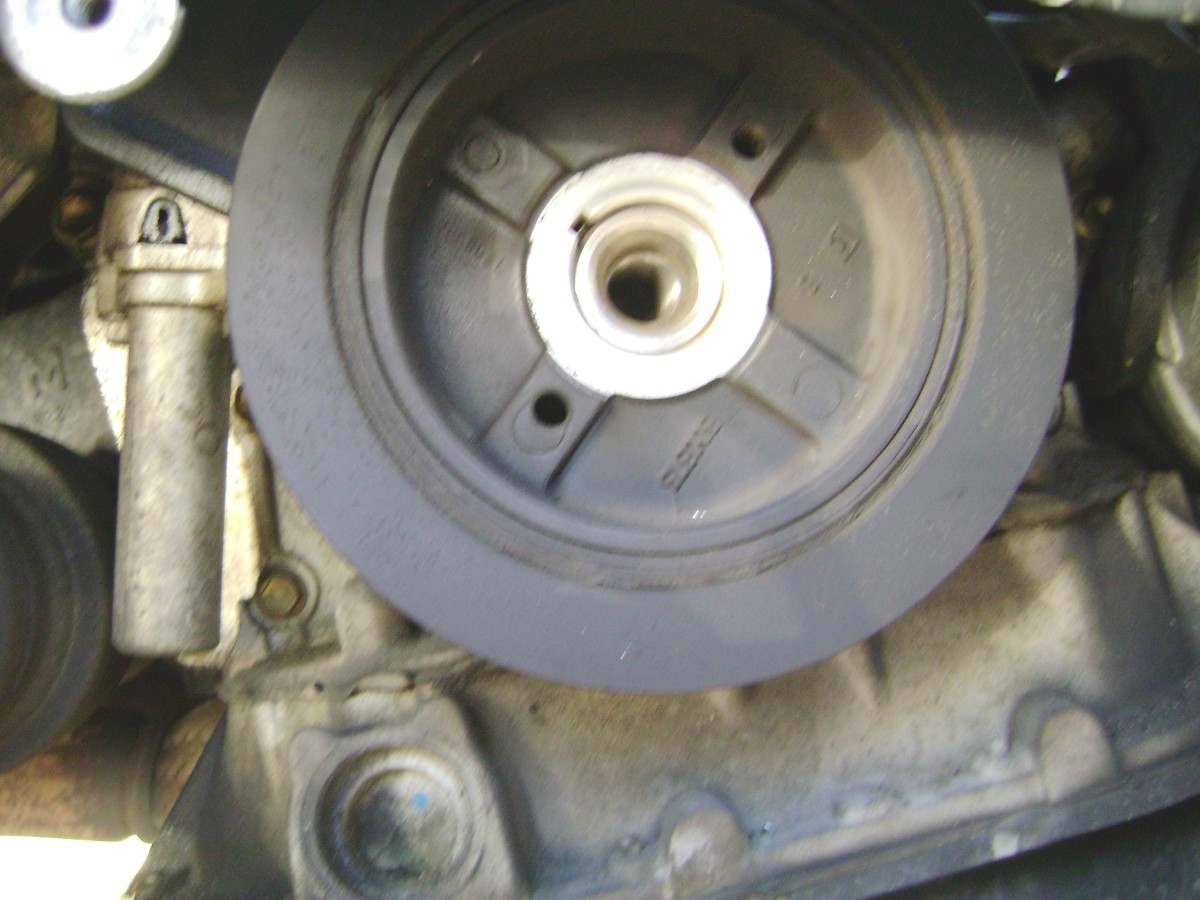 N.  Crankshaft pulley after bolt removed