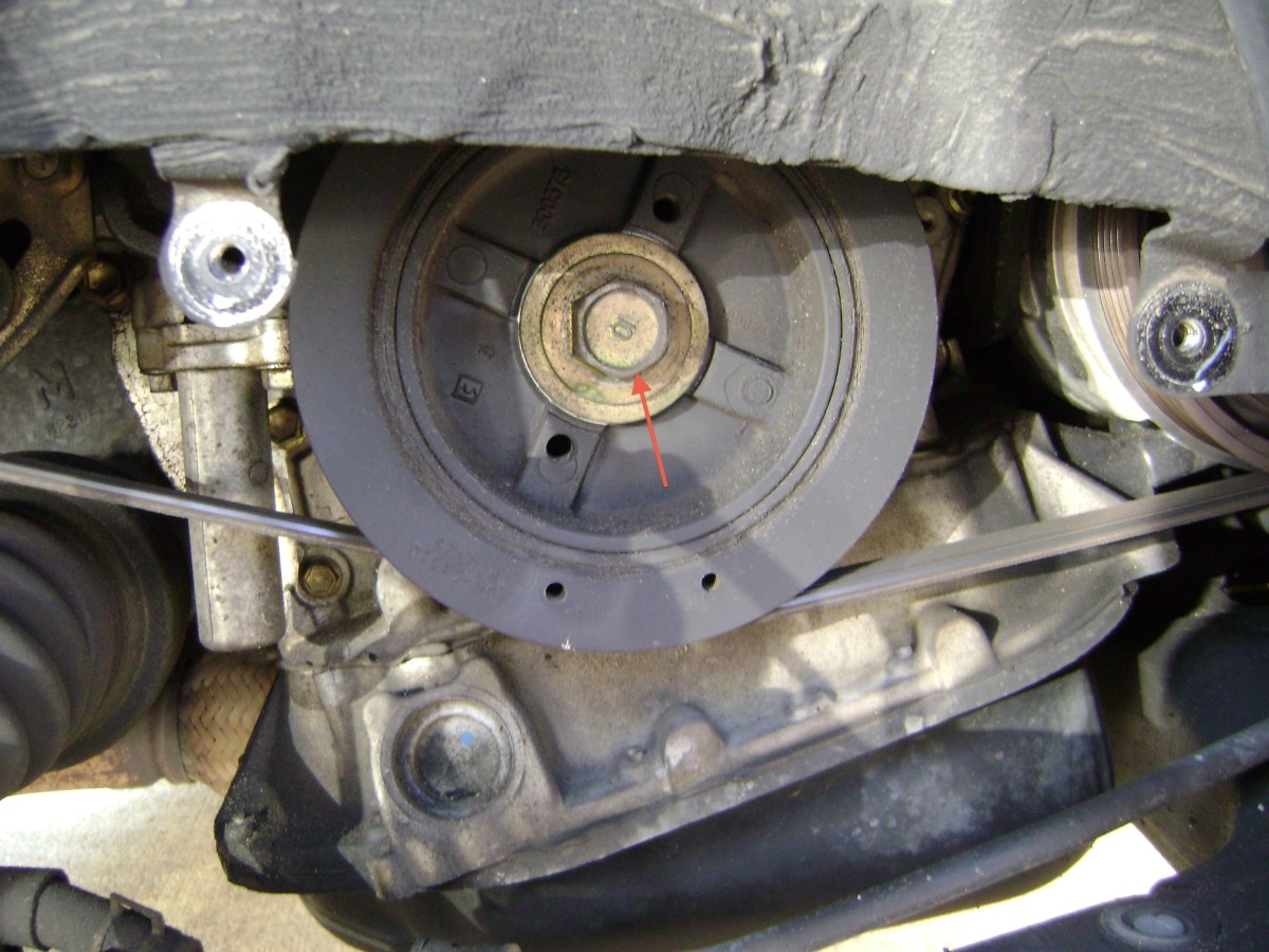 B. Remove the crankshaft pulley bolt.