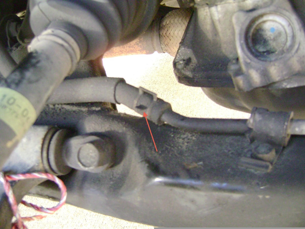 G.  Remove power steering hose clamp and hose.