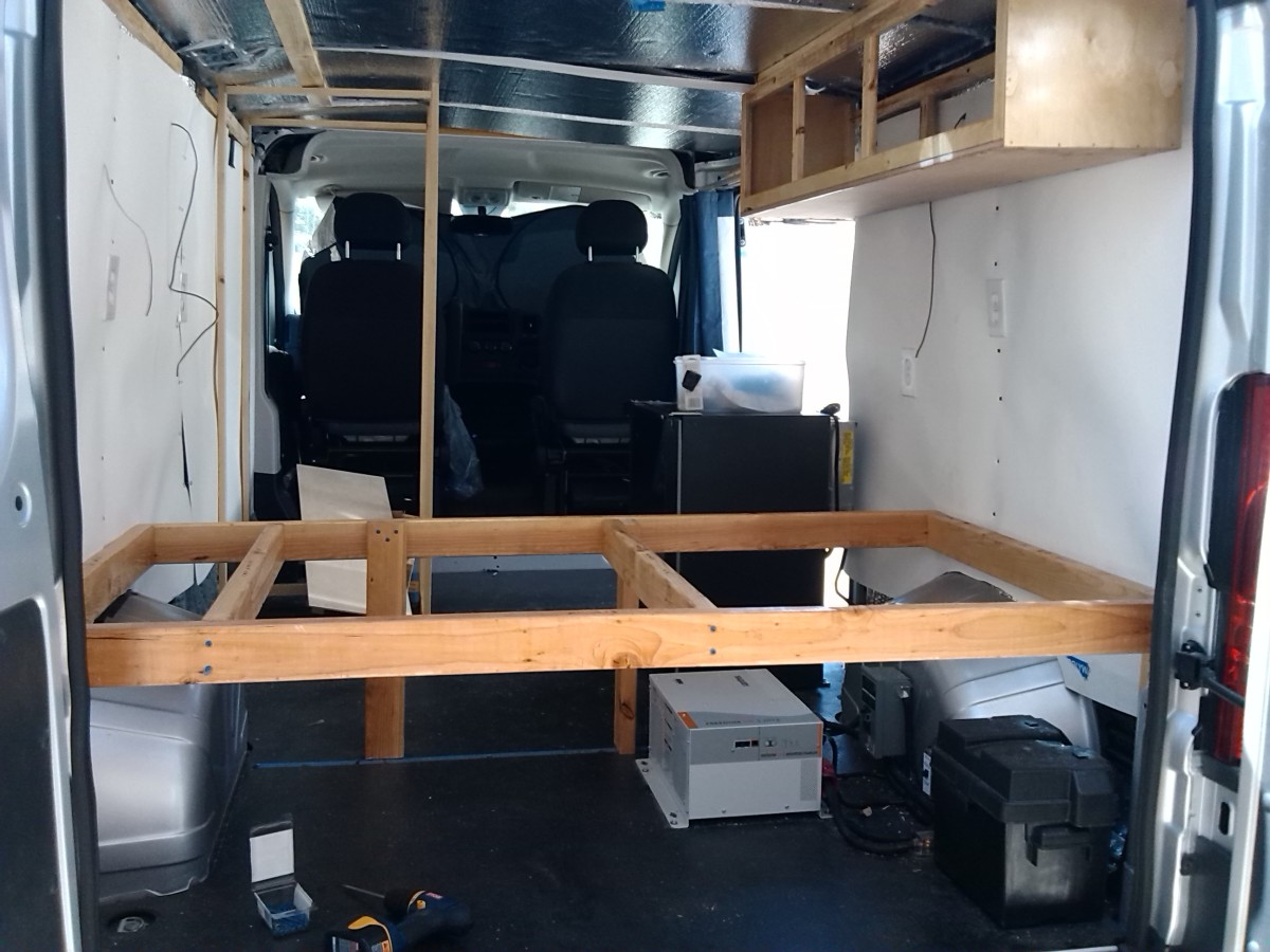 Bed frame with electrical equipment under the foot and storage under the head of the bed.