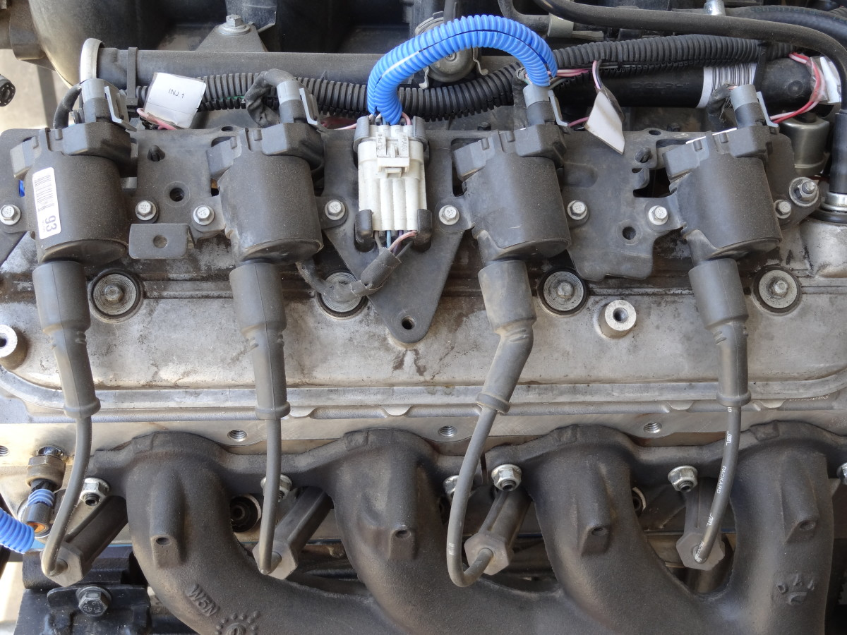 Each cylinder has it's own coil but a short spark plug wire connects to the spark plug. Chevy V8 pictured.