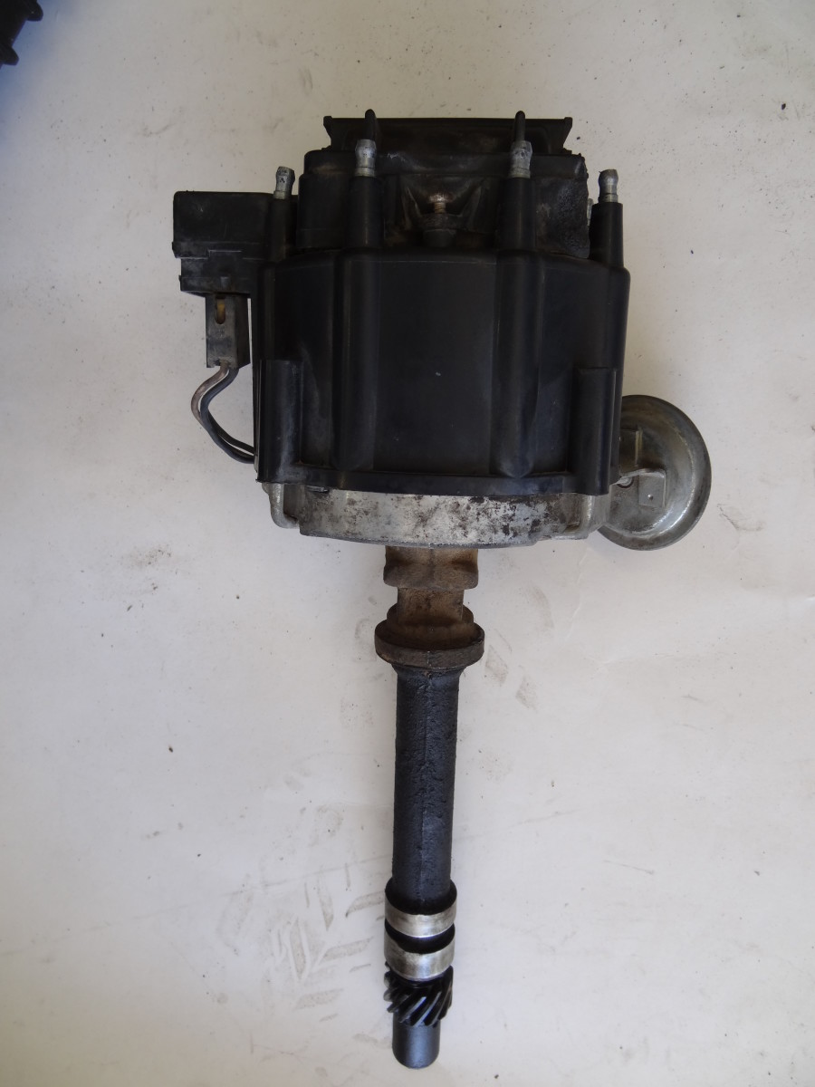 HEI distributors contained the ignition coil in the top of the distributor cap. The HEI only needed 12V to operate.