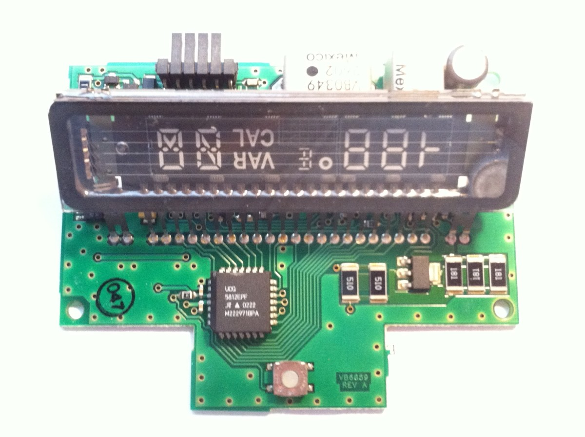 LCD Vacuum Fluorescent display manufactured in Mexico for the 2001 Ford Explorer Sportrac. Displays compass and external temperature.
