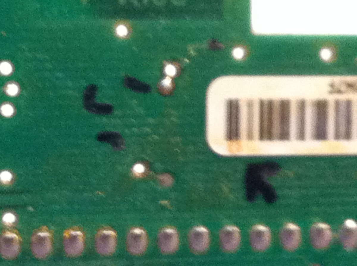 Notice that the UPC label is covering one of the solder points. I chose to leave it alone, but this could also contribute to a fault over time.