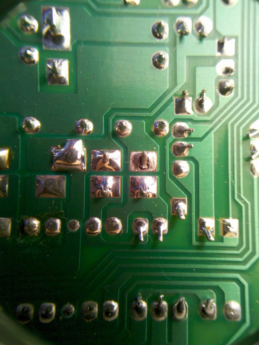 The Electric Window Module circuit board fault with a dry solder joint at the picture's centre.