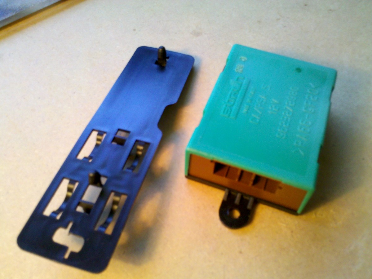 Photo 2  shows the ECM and its plastic backplate detached from the car.