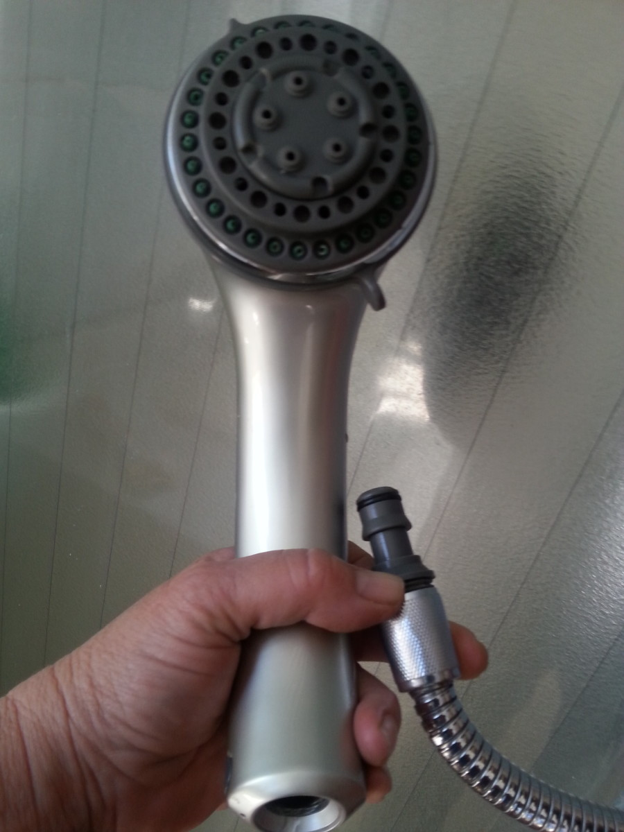My shower head can reach outside the shower cubicle. (A common shower style that can be removed and held in your hand.) Removing the head reveals the same type of connection as my garden hose. Great for portable washing machines!