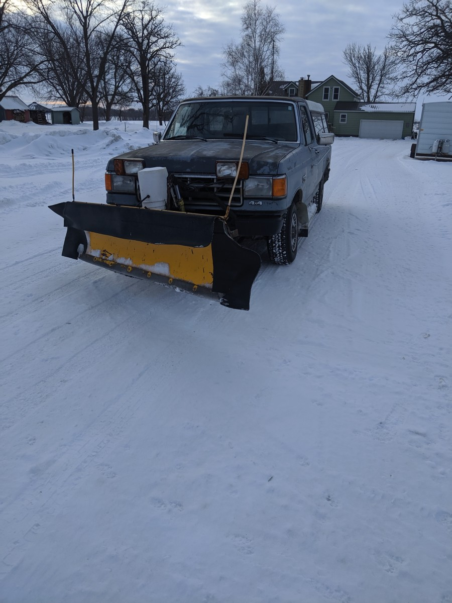How to Use a Truck-Mounted Snowplow to Move Snow Into Piles