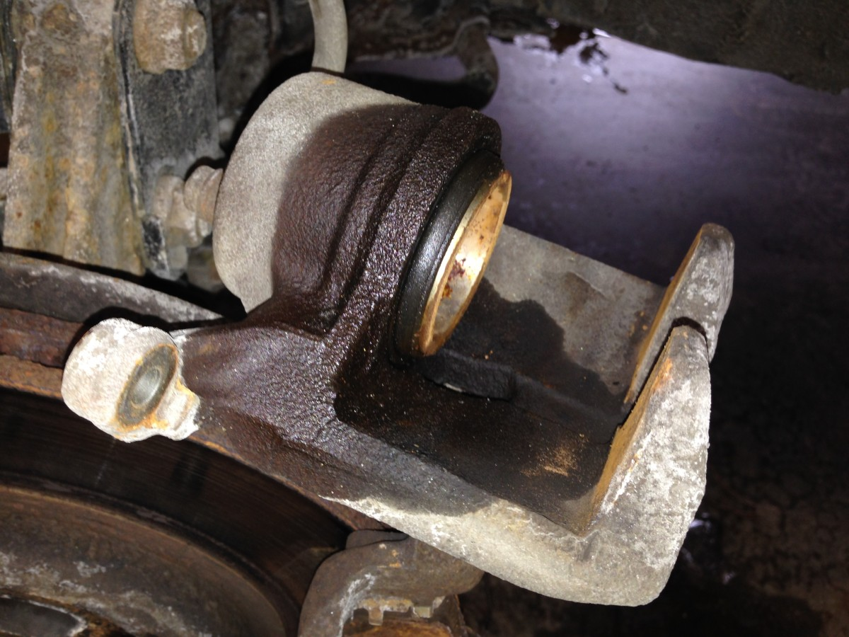 This caliper is leaking past the piston o-ring and needs to be replaced because it is beyond repair.