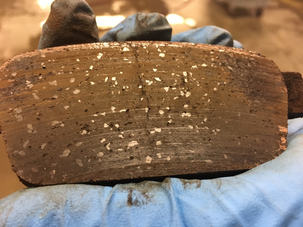 This brake pad was overheated and has a crack down the middle. The pad material was so brittle it was causing a grinding noise.