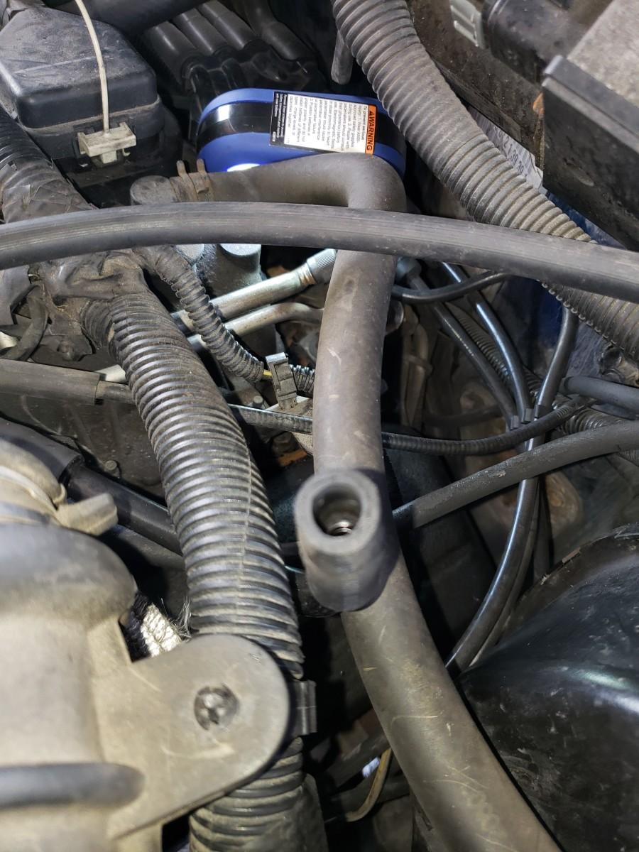 Remove the PCV valve.