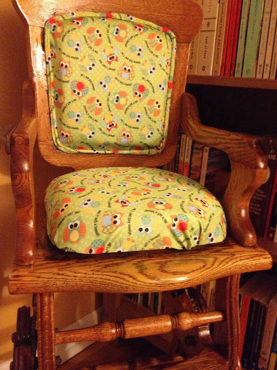 The finished chair.  I left off the tray to show the back and seat padding and newly refinished wood.