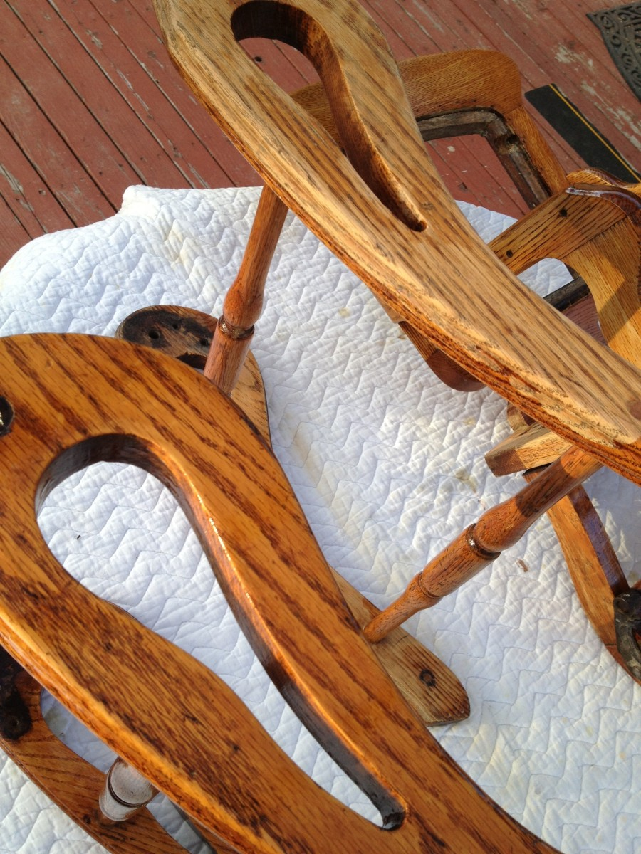 Paint stripper will easily remove the old varnish from your wood pieces and preserve the aged look of the wood, which sanding may remove.