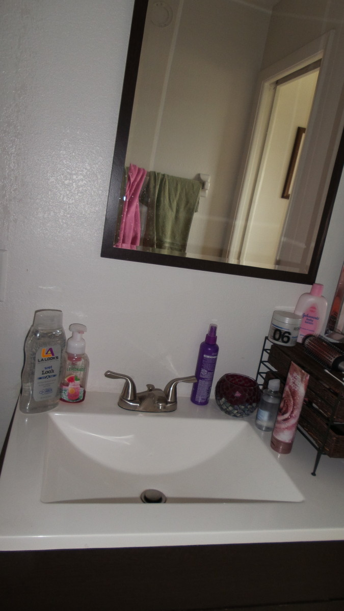 Storage is so very important to keeping a bathroom looking tidy!!  Photo by AMB