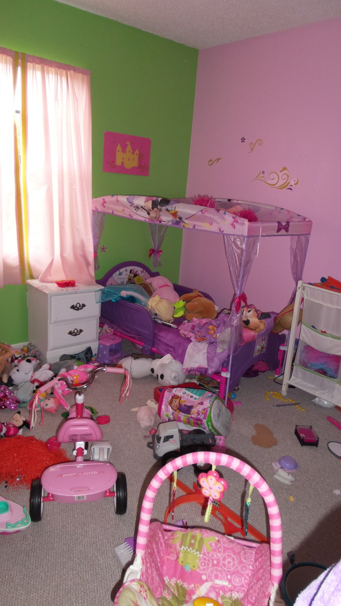Do your kids' rooms look like this?  Again, adequate storage is the key!!  And, sneaking their old toys out of the house under the cover of darkness.  Photo by AMB