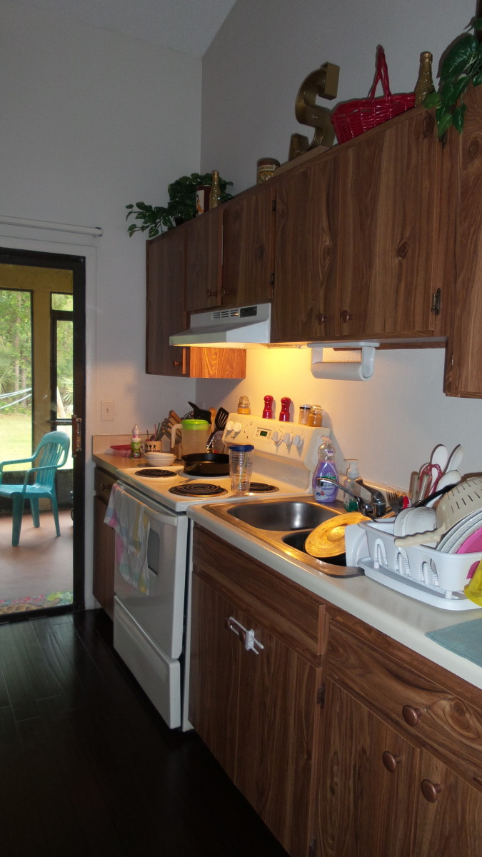 Yep, my tiny kitchen gets cluttered and messy pretty quickly! Cutting down on clutter helps to minimize this. Photo by AMB