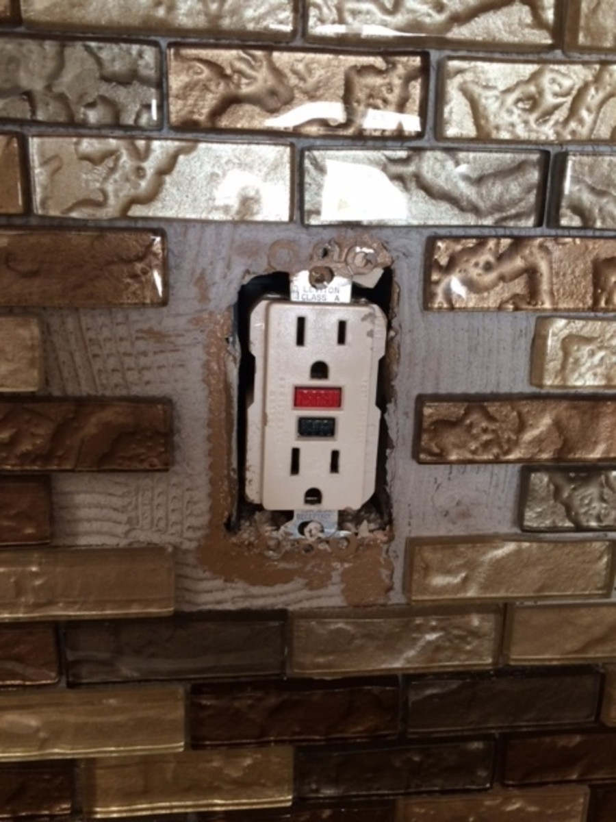 Cut tiles to work around outlets