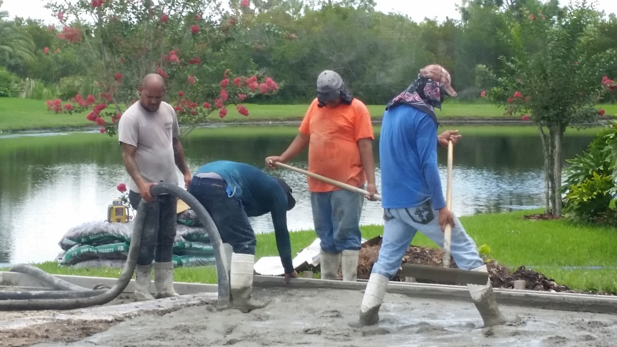 It took a full crew to spread the concrete as it was pumped to the patio.